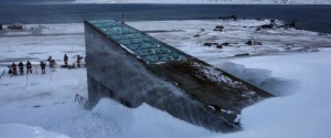 """Snow blows off the Svalbard Global Seed Vault before being inaugurated at sunrise, Tuesday, Feb. 26, 2008. The """"doomsday"""" seed vault built to protect millions of food crops from climate change, wars and natural disasters opened Tuesday deep within an Arctic mountain in the remote Norwegian archipelago of Svalbard. (AP Photo/John McConnico)"""