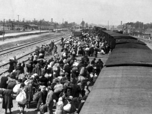 A photo taken 27 May 1944 in Oswiecim, showing Jews alighting from a train in the Auschwitz-Birkenau extermination camp. The Auschwitz camp was established by the Nazis in 1940, in the suburbs of the city of Oswiecim which, like other parts of Poland, was occupied by the Germans during the Second World War. The name of the city of Oswiecim was changed to Auschwitz, which became the name of the camp as well. Over the following years, the camp was expanded and consisted of three main parts: Auschwitz I, Auschwitz II-Birkenau, and Auschwitz III-Monowitz. Red Army soldiers liberated the few thousand prisoners whom the Germans had left behind in the camp, 27 January 1945. AFP PHOTO/ YAD VASHEM ARCHIVES